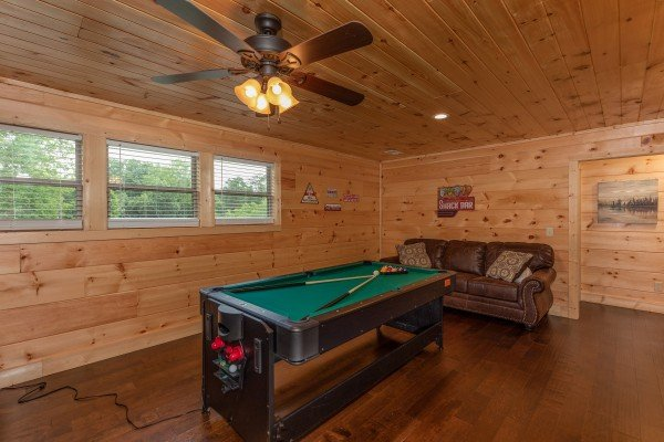 Convertible pool table in the game room at Always Dream'n, a 6 bedroom cabin rental located in Pigeon Forge