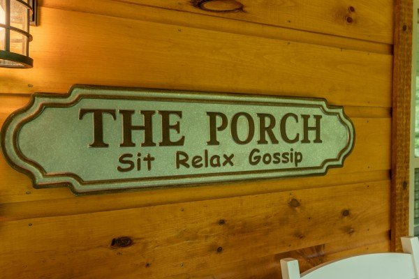 Porch sign at Always Dream'n, a 6 bedroom cabin rental located in Pigeon Forge