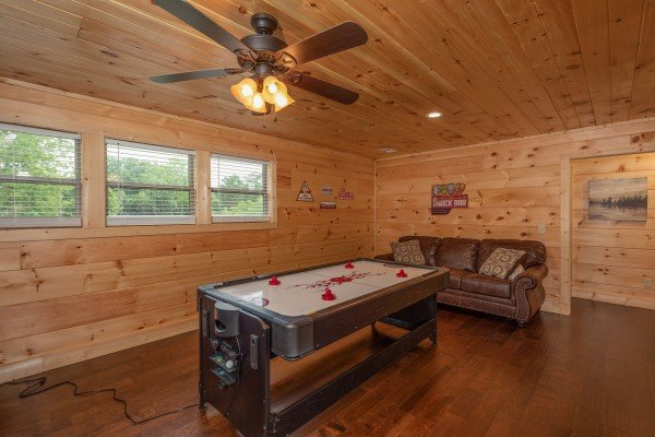 Convertible air hockey table in the game room at Always Dream'n, a 6 bedroom cabin rental located in Pigeon Forge