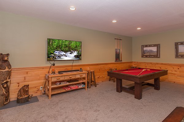 TV and pool table in the game room at Mountain Harvest, a 3 bedroom cabin rental located in Pigeon Forge