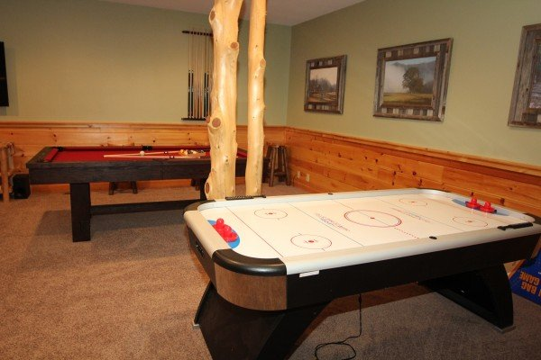 Air hockey table and pool table in the game room at Mountain Harvest, a 3 bedroom cabin rental located in Pigeon Forge