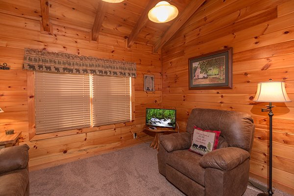 Chair and TV in the loft sitting area at Mountain Harvest, a 3 bedroom cabin rental located in Pigeon Forge