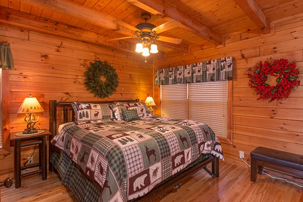 Bedroom with king bed at Mountain Harvest, a 3 bedroom cabin rental located in Pigeon Forge