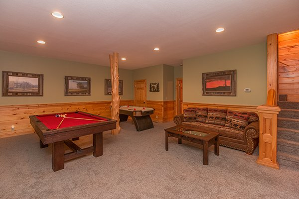 Game room on the lower level at Mountain Harvest, a 3 bedroom cabin rental located in Pigeon Forge