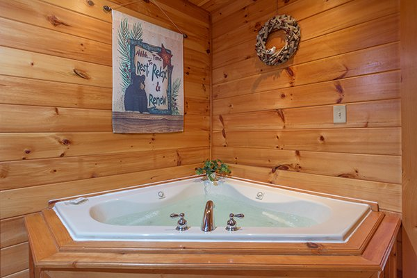 Jacuzzi tub in a corner at Mountain Harvest, a 3 bedroom cabin rental located in Pigeon Forge