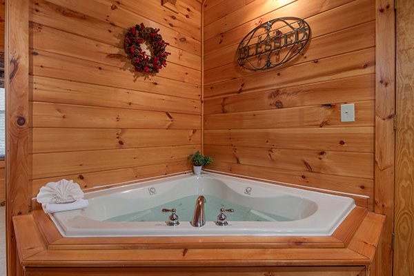 Jacuzzi tub in the loft space at Mountain Harvest, a 3 bedroom cabin rental located in Pigeon Forge