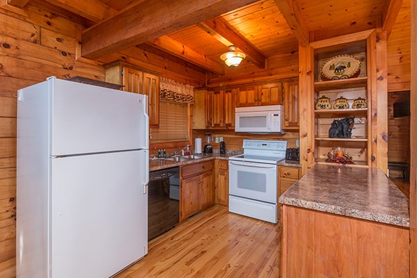 Kitchen with white appliances at Mountain Harvest, a 3 bedroom cabin rental located in Pigeon Forge