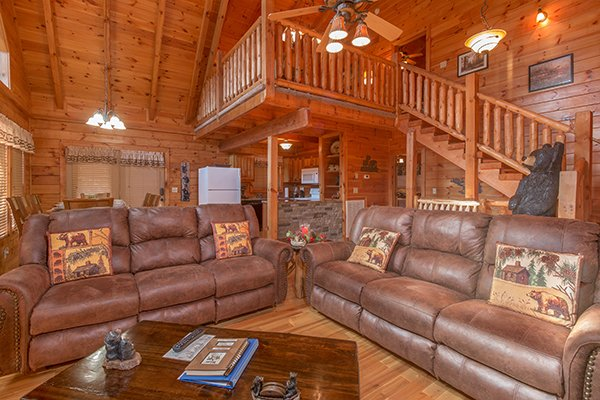 Vaulted living room with two sofas at Mountain Harvest, a 3 bedroom cabin rental located in Pigeon Forge