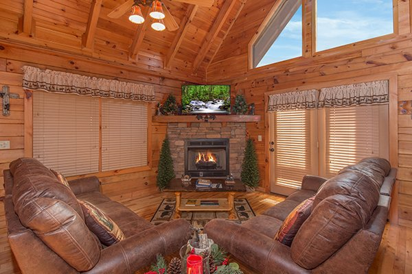 Living room with a fireplace and TV at Mountain Harvest, a 3 bedroom cabin rental located in Pigeon Forge