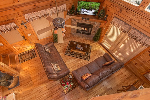 Looking down into the living room from the upper floor at Mountain Harvest, a 3 bedroom cabin rental located in Pigeon Forge