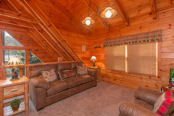 Loft seating area at Mountain Harvest, a 3 bedroom cabin rental located in Pigeon Forge