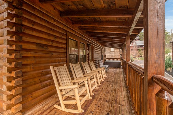 Rocking chairs on the covered deck at Mountain Harvest, a 3 bedroom cabin rental located in Pigeon Forge