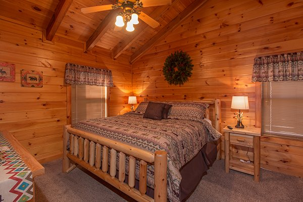 Bedroom with a king log bed in the loft space at Mountain Harvest, a 3 bedroom cabin rental located in Pigeon Forge
