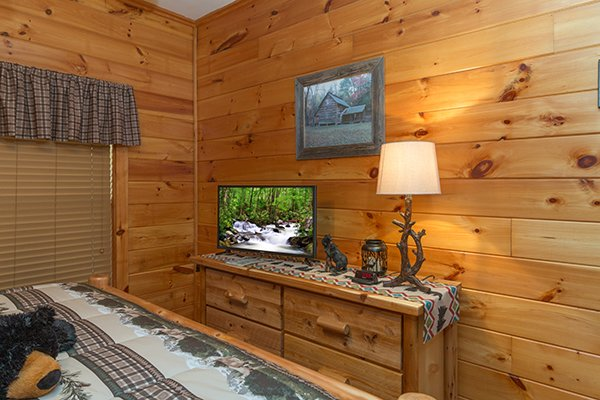 Dresser and TV in the bedroom at Mountain Harvest, a 3 bedroom cabin rental located in Pigeon Forge