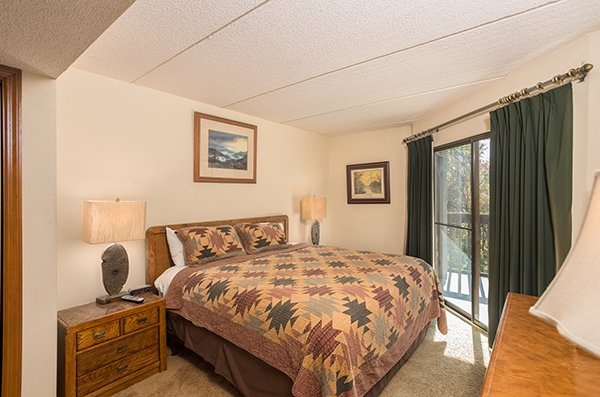 Bedroom with patio access at High Alpine #204, a 2 bedroom cabin rental located in Gatlinburg