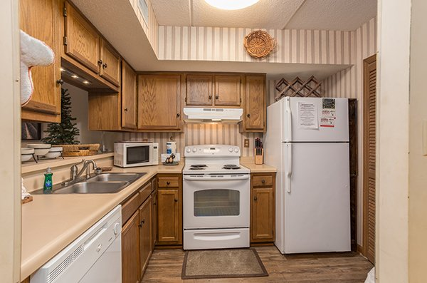 Kitchen with white appliances at High Alpine #204, a 2 bedroom cabin rental located in Gatlinburg