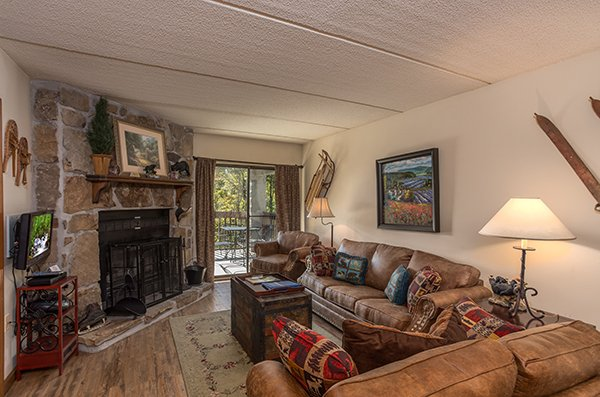 Living room with a fireplace and TV at High Alpine #204, a 2 bedroom cabin rental located in Gatlinburg