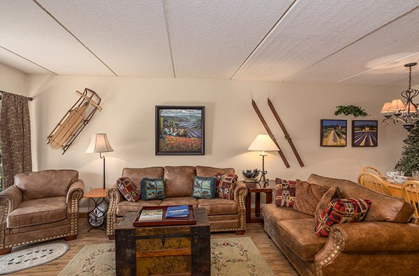 Living room with couch, loveseat, and chair at High Alpine #204, a 2 bedroom cabin rental located in Gatlinburg