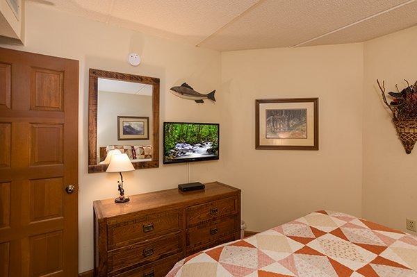 Bedroom with a dresser and TV at High Alpine #204, a 2 bedroom cabin rental located in Gatlinburg