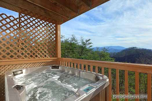 Covered deck with hot tub at Sunset Vista View, a 1 bedroom cabin rental located in Pigeon Forge