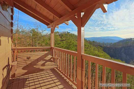Covered deck with porch swing at Sunset Vista View, a 1 bedroom cabin rental located in Pigeon Forge