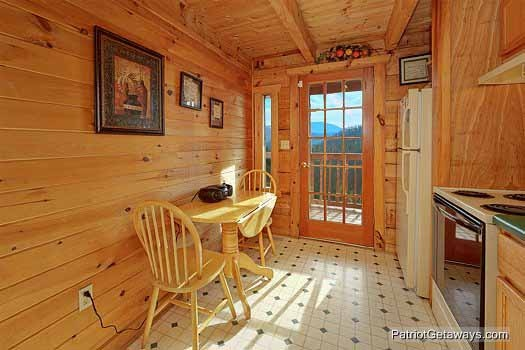 eat in kitchen area at sunset vista view a 1 bedroom cabin rental located in pigeon forge