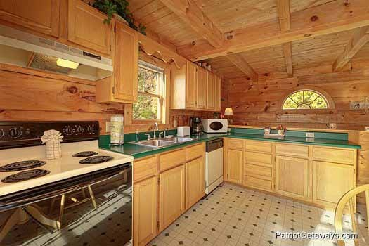 kitchen area at sunset vista view a 1 bedroom cabin rental located in pigeon forge