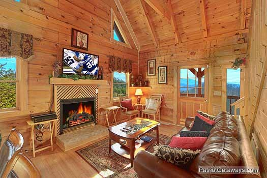 living room with fireplace at sunset vista view a 1 bedroom cabin rental located in pigeon forge