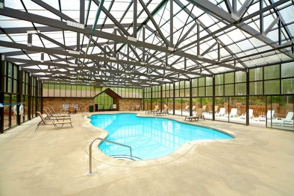 Indoor pool for guests at Pool Side Lodge, a 6 bedroom cabin rental located in Pigeon Forge