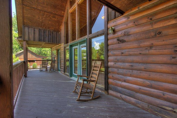 Rocking chairs on the upper deck at Pool Side Lodge, a 6 bedroom cabin rental located in Pigeon Forge