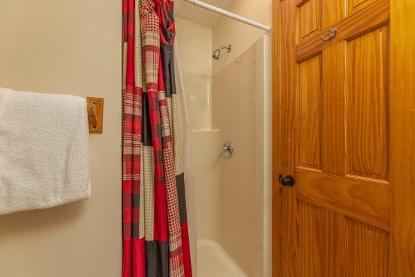 Bathroom with a shower at Pool Side Lodge, a 6 bedroom cabin rental located in Pigeon Forge