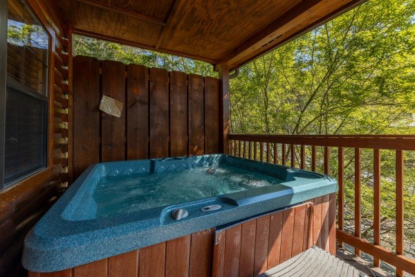 Hot tub on the deck at Pool Side Lodge, a 6 bedroom cabin rental located in Pigeon Forge