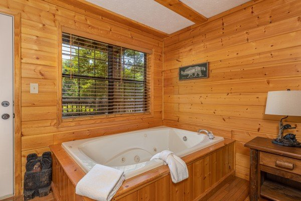In room jacuzzi at Pool Side Lodge, a 6 bedroom cabin rental located in Pigeon Forge
