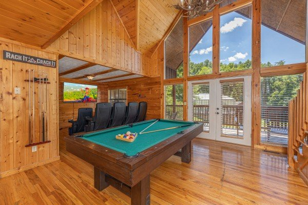 Pool table in a lofted space at Pool Side Lodge, a 6 bedroom cabin rental located in Pigeon Forge