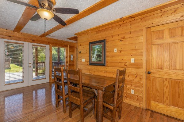 Dining table at Pool Side Lodge, a 6 bedroom cabin rental located in Pigeon Forge