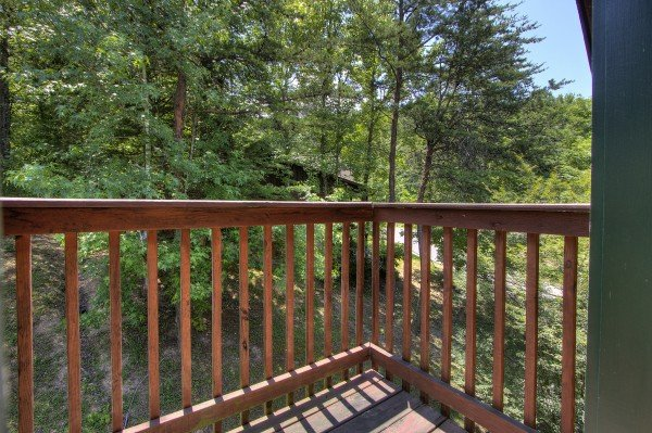 Tree views from the upper private deck at Pool Side Lodge, a 6 bedroom cabin rental located in Pigeon Forge