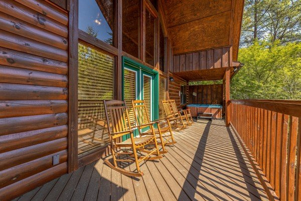 Upper deck with rocking chairs at Pool Side Lodge, a 6 bedroom cabin rental located in Pigeon Forge