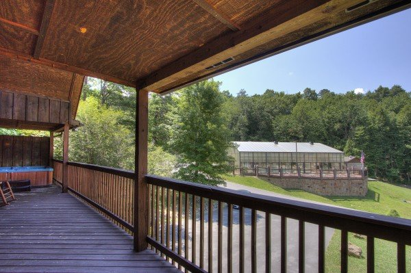 Hot tub deck with a view of the indoor pool at Pool Side Lodge, a 6 bedroom cabin rental located in Pigeon Forge