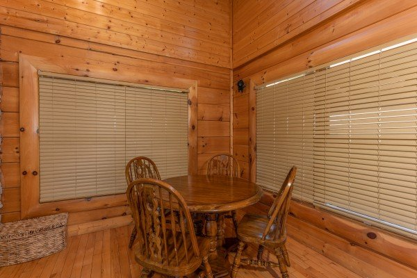 Dining table for four at Bear Bottom Retreat, a 4 bedroom cabin rental located in Pigeon Forge