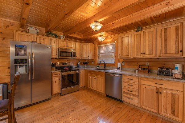 Stainless steel appliances in the kitchen at Bear Bottom Retreat, a 4 bedroom cabin rental located in Pigeon Forge