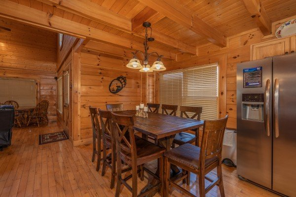 Dining table for 8 in the kitchen at Bear Bottom Retreat, a 4 bedroom cabin rental located in Pigeon Forge