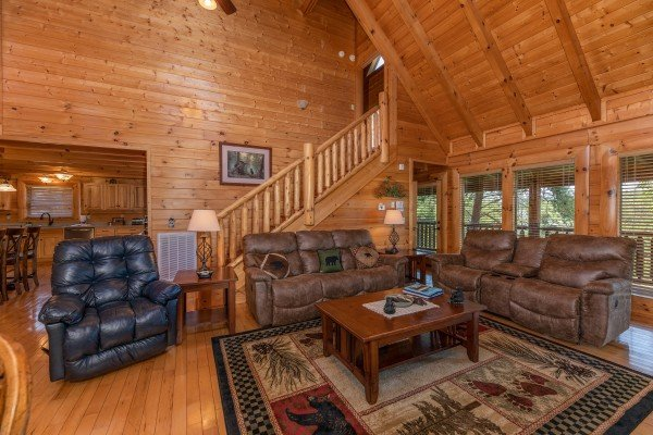 Living room with sofas and recliners at Bear Bottom Retreat, a 4 bedroom cabin rental located in Pigeon Forge