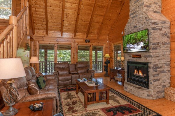 Fireplace & TV in the living room at Bear Bottom Retreat, a 4 bedroom cabin rental located in Pigeon Forge