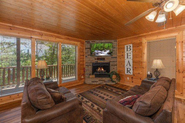 Lower level living room at Bear Bottom Retreat, a 4 bedroom cabin rental located in Pigeon Forge