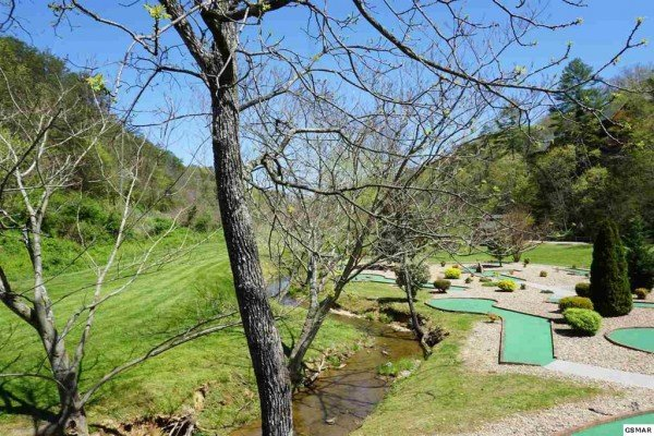 Mini golf course access for guests at Bear Bottom Retreat, a 4 bedroom cabin rental located in Pigeon Forge
