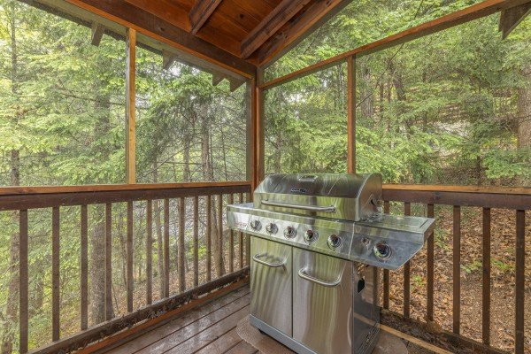 Gas grill on a covered deck at Location Location Location, a 1 bedroom cabin rental located in Pigeon Forge