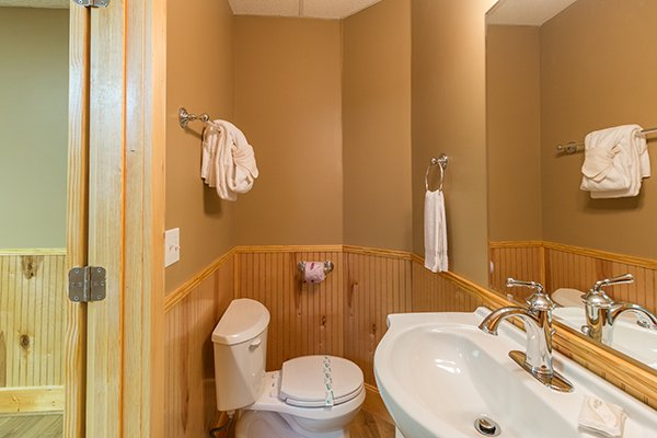 Half bath off the game room at Location Location Location, a 1 bedroom cabin rental located in Pigeon Forge