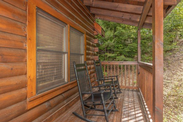 Rocking chairs on the porch at Location Location Location, a 1 bedroom cabin rental located in Pigeon Forge