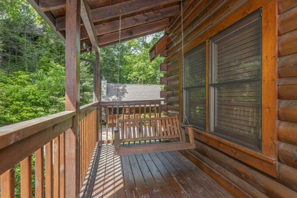 Porch swing at Location Location Location, a 1 bedroom cabin rental located in Pigeon Forge