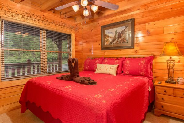 Bedroom with a king-sized bed at Bearfoot Lodge, a 5-bedroom cabin rental located in Pigeon Forge